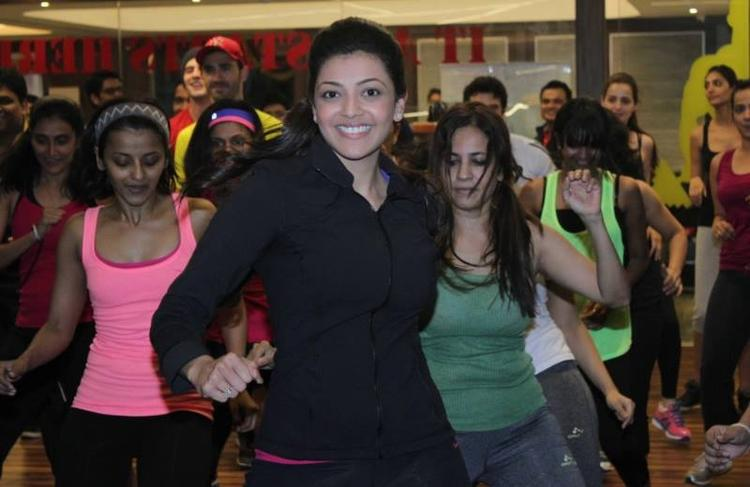 Actress Kajal Exercise Stills At Zumba Session Gold Gym