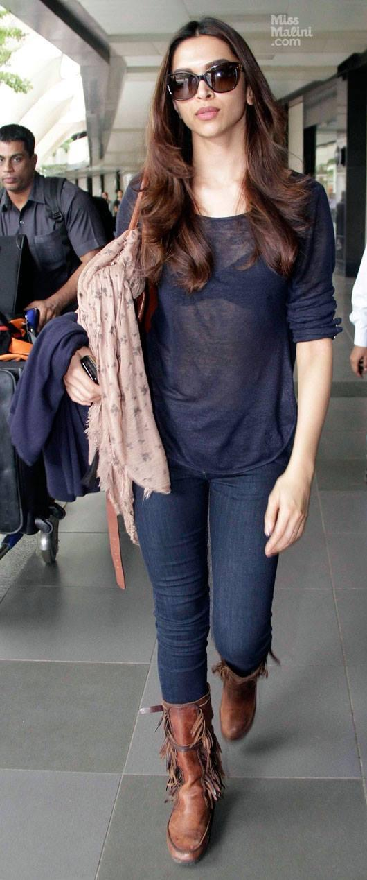 Deepika Padukone Comfortable With Black See Through Top,Denims And A Pair Of Gorgeous Boots At Mumbai Airport