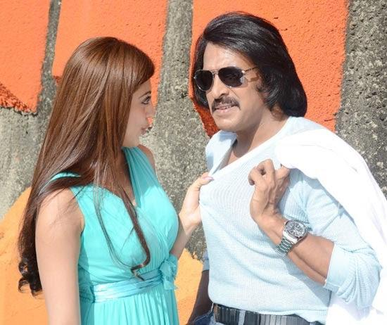 Pranitha And Upendra A Still From Brahma - The Leader Movie