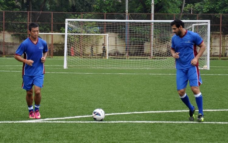 Bollywood Actor John And Former Indian Football Team Captain Baichung During A IMG-Reliance Training Camp In Mumbai