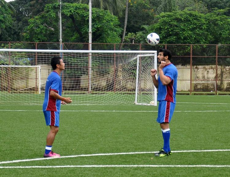John And Baichung On The Field Of  Reliance Football League