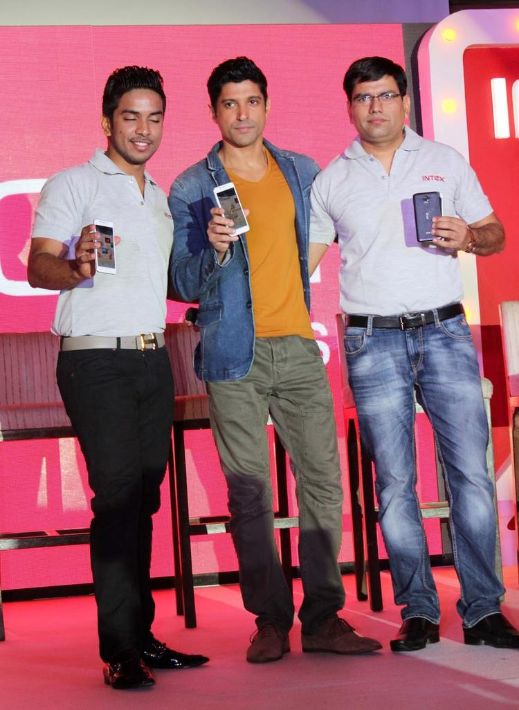 Farhan Akhtar Pose With Intex Aqua I7 Smartphone In Mumbai