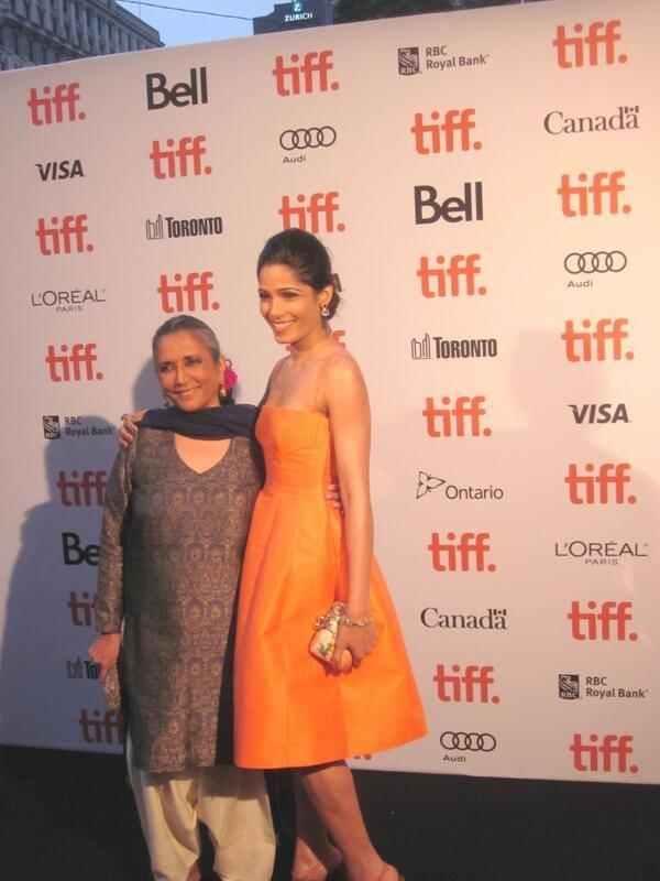 Freida Pinto Wear A Sleeveless Orange Color Dress At TIFF 2013