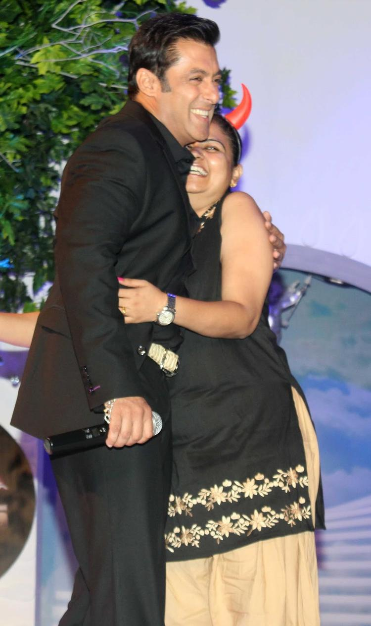 Salman Khan Hugs A Fan During The Press Launch Of Bigg Boss 7