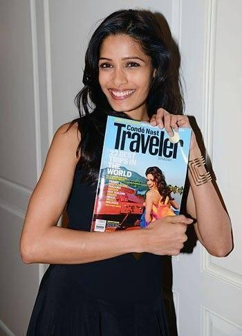 Freida Pinto Posed With A Magazine At Conde Nast 2013 Global Visionaries Event