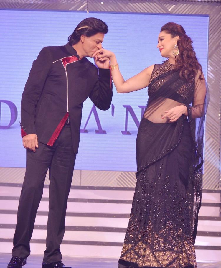 SRK Kisses Madhuri's Hand On Ramp At Late Yash Chopra's 81st Birth Anniversary