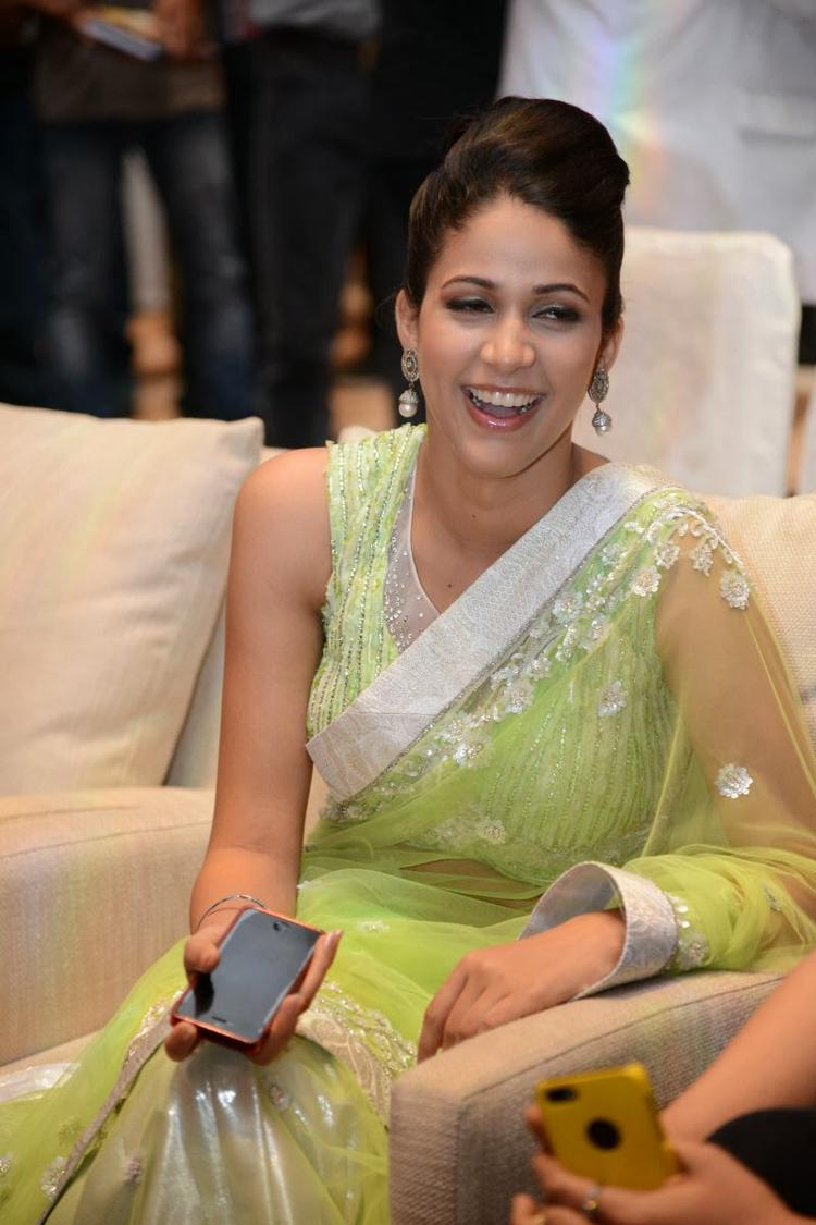 Lavanya In Light Yellow Green Transparent Saree Cool Smiling During The Audio Release Function Of Doosukeltha Movie