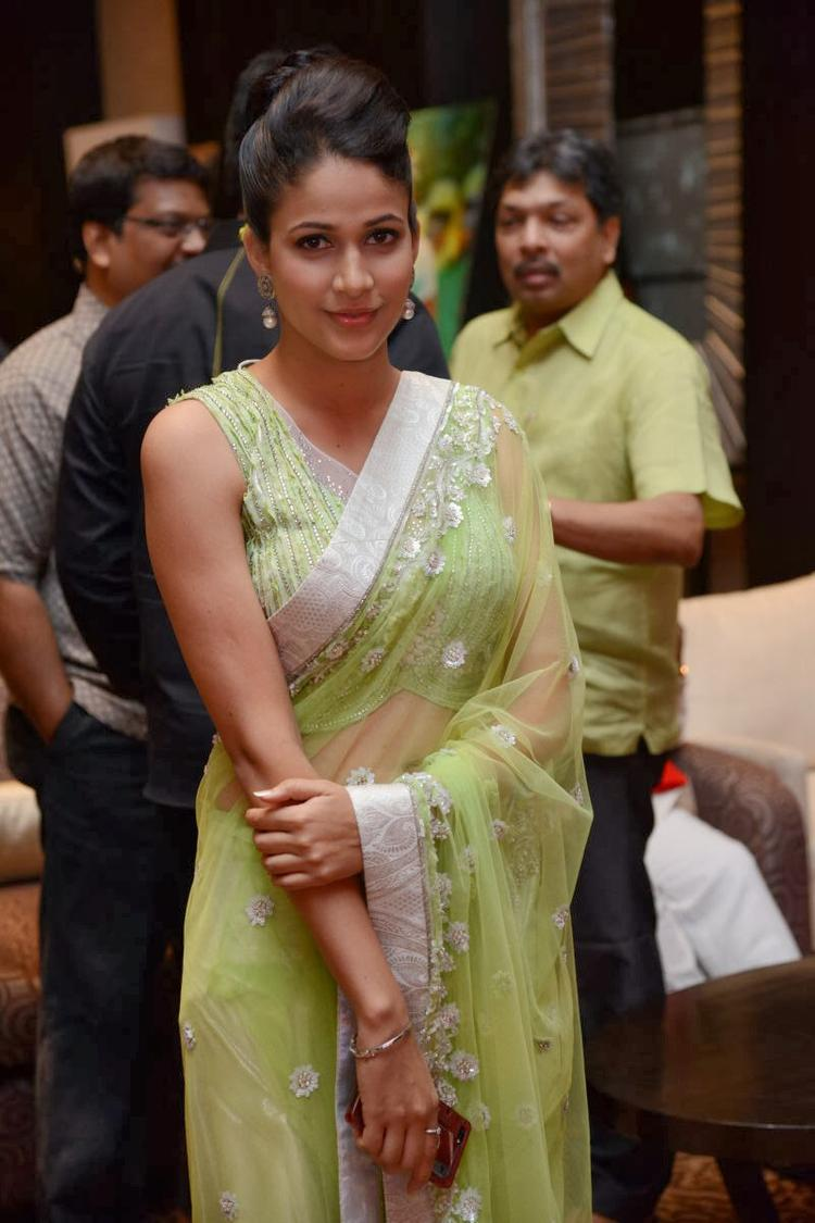 Lavanya In Light Yellow Green Transparent Saree Hot Look During The Audio Release Function Of Doosukeltha Movie