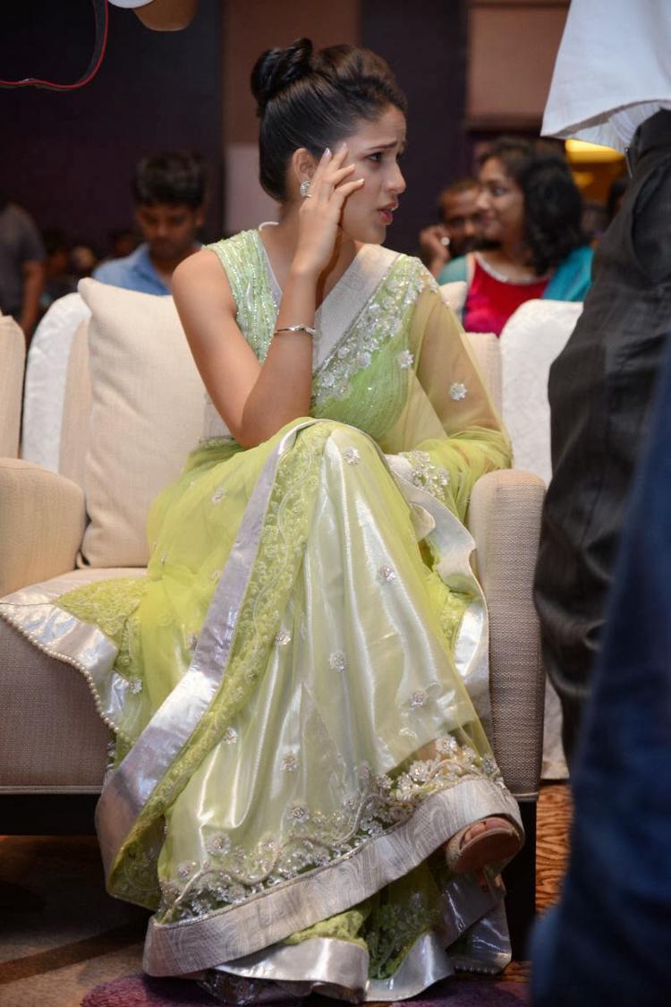 Lavanya In Light Yellow Green Transparent Saree Present At Doosukeltha Movie Audio Release Function