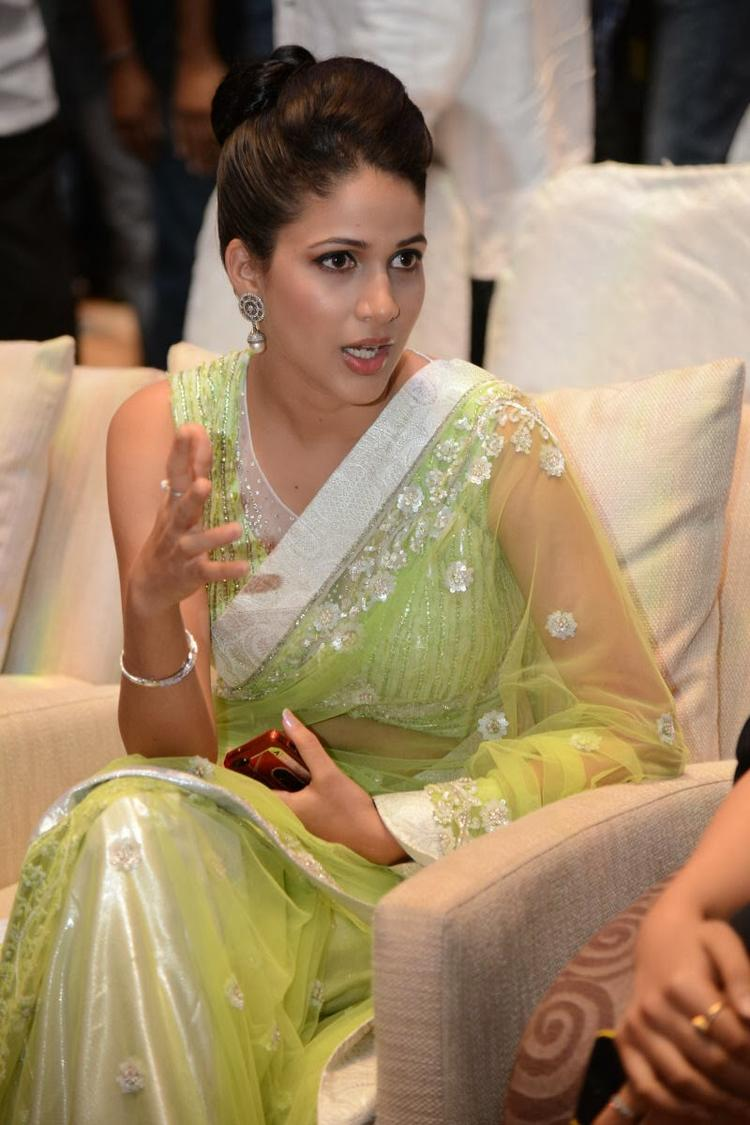 Lavanya In Light Yellow Green Transparent Saree Sexy Look During The Audio Release Function Of Doosukeltha Movie
