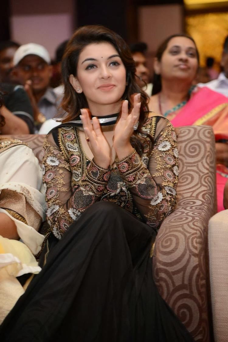Hansika Motwani Clapping Still During The Audio Release Function Of Doosukeltha Movie