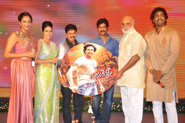 Lakshmi Prasanna Manchu,Lavanya Tripathi,Veeru Potla And Manchu Vishnu Posed With Audio CD During The Audio Launch Of Doosukeltha Movie