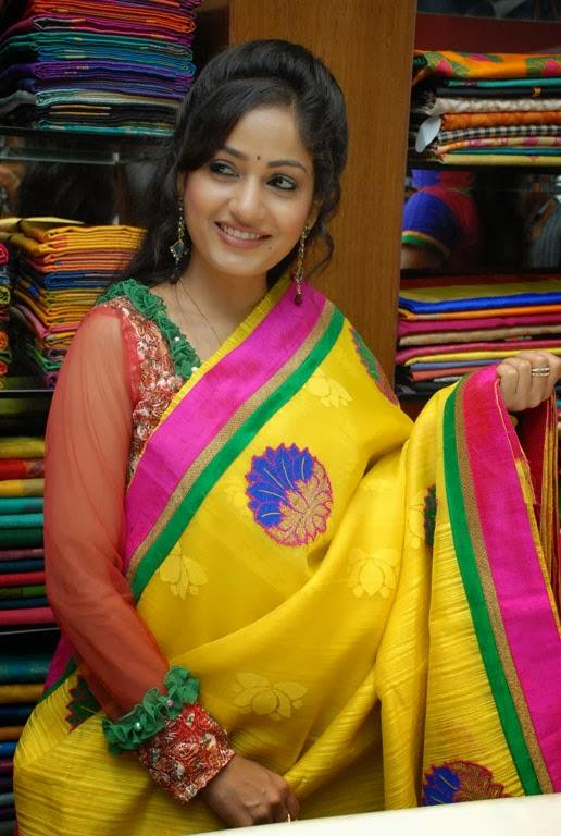 Madhavi Latha Shows A Saree To The Camera During The Launch Of Sreeja Fashions South Silk Festival 2013