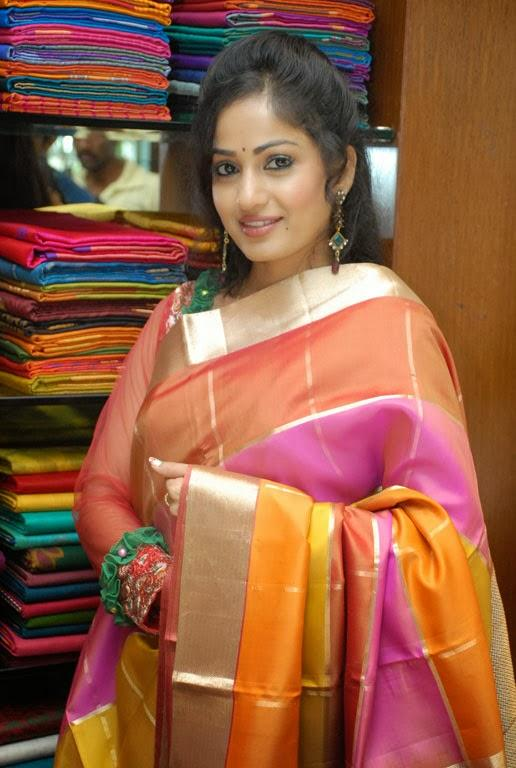 Madhavi Latha Shows A Saree During The Launch Of Sreeja Fashions South Silk Festival 2013