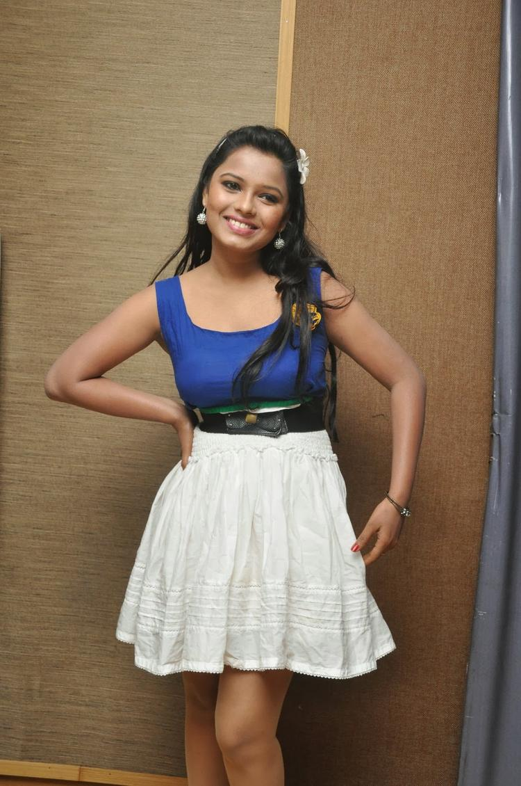 Naveena Jackson Cute Pose In Blu Tops And White Gown