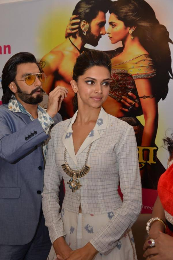 Ranveer Clearing Out The Flower Petals Off Deepika's Hair During The Promotion At Hyderabad