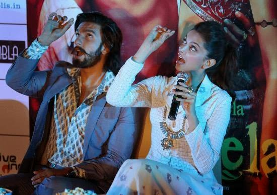 Ranveer And Deepika Strikes A Pose From The Movie Ram Leela During A Press Meet