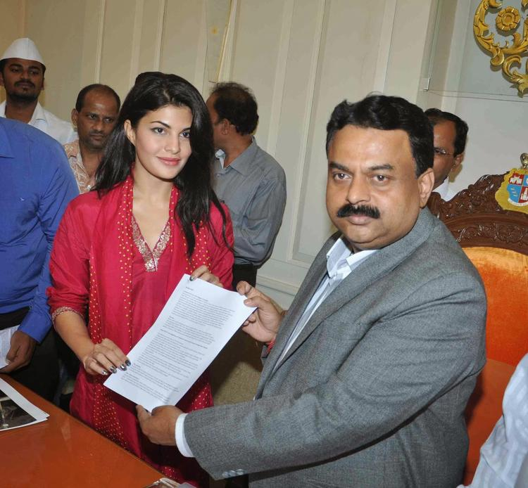 Jacqueline And Sunil During The PETA To Ban Horse Carriages Event