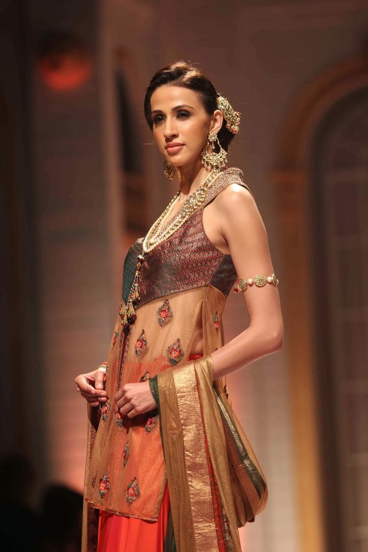 A Model Strikes A Pose While Displaying A Creation By Ashima Leena During Aamby Valley Indian Bridal Fashion Week
