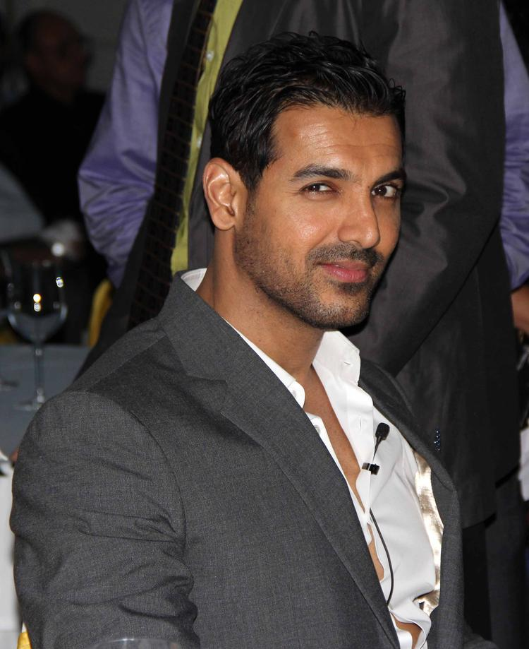 John Abraham Sweet Smile Pic During The SCMM Press Conference
