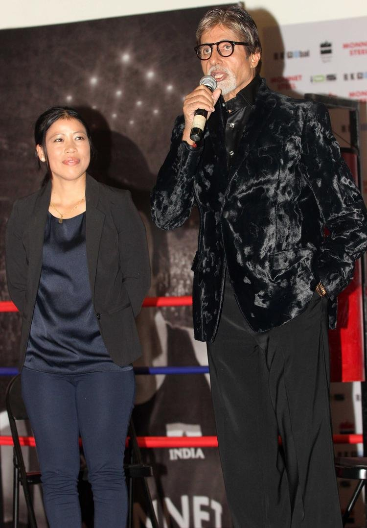 Big B Addresses The Media And Mary Kom Looks On During The Launch Of Mary Kom's Biography Unbreakable