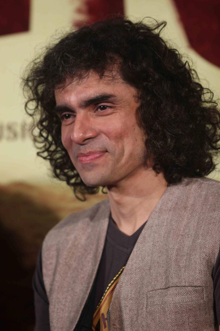 Imtiaz Ali Cool Smiling Look During The First Look Launch Of Highway Movie