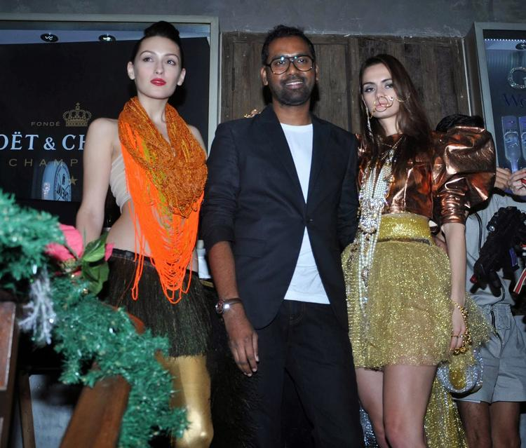 Photographer Prasad Naik Posed With Model At His Photography Art Work Launch Event