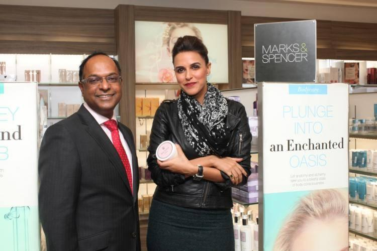 Neha Pose With Managing Director Venu Nair At The Launch Of New Marks And Spencer Store