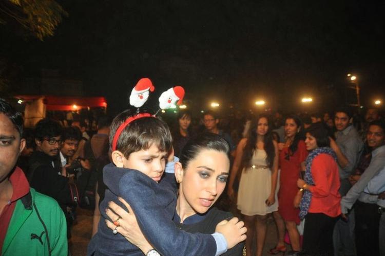 Karisma With Son Kiaan Raj Arrives For The Christmas Midnight Mass At A Church In Mumbai