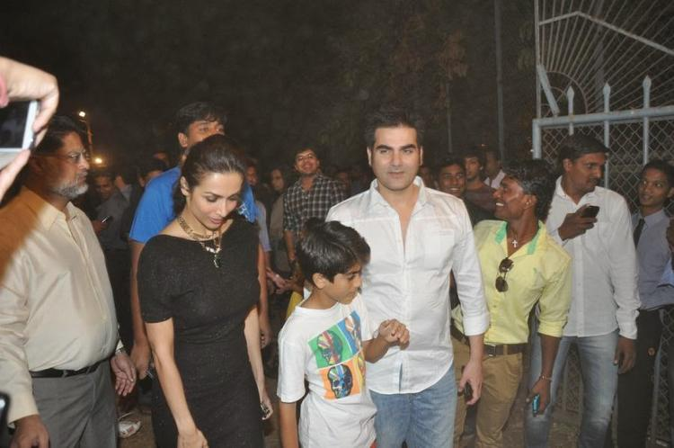 Malaika With Arbaaz And Son Arhaan Attending The Midnight Mass On Christmas Eve At A Church In Mumbai