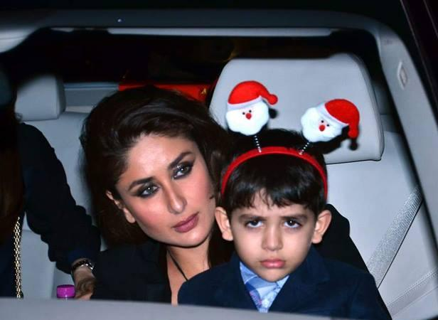 Kareena Holds On To A Cranky Kiaan During Christmas Midnight Mass Party 2013