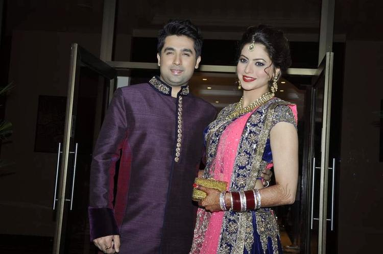 Aamna Sharif And Amit Pose During Their Wedding Reception