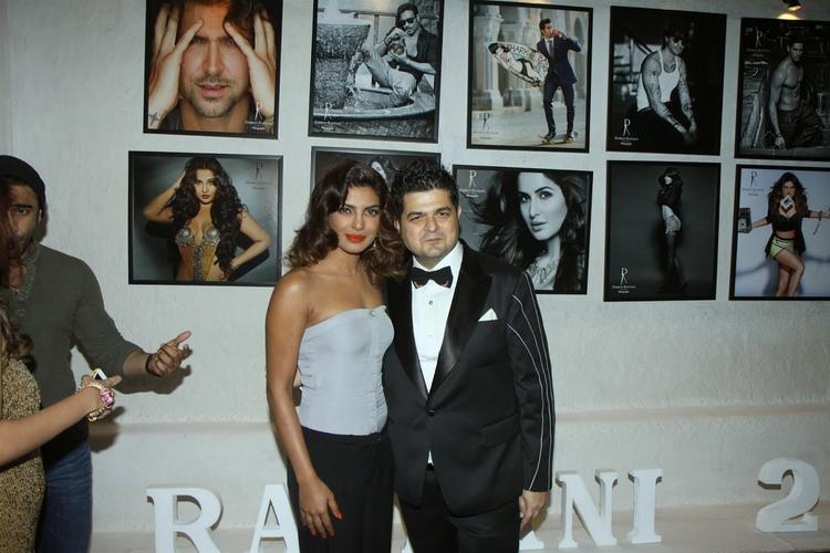 Priyanka And DabbooPose During The Dabboo Ratnani's 2014 Calendar Launch Event