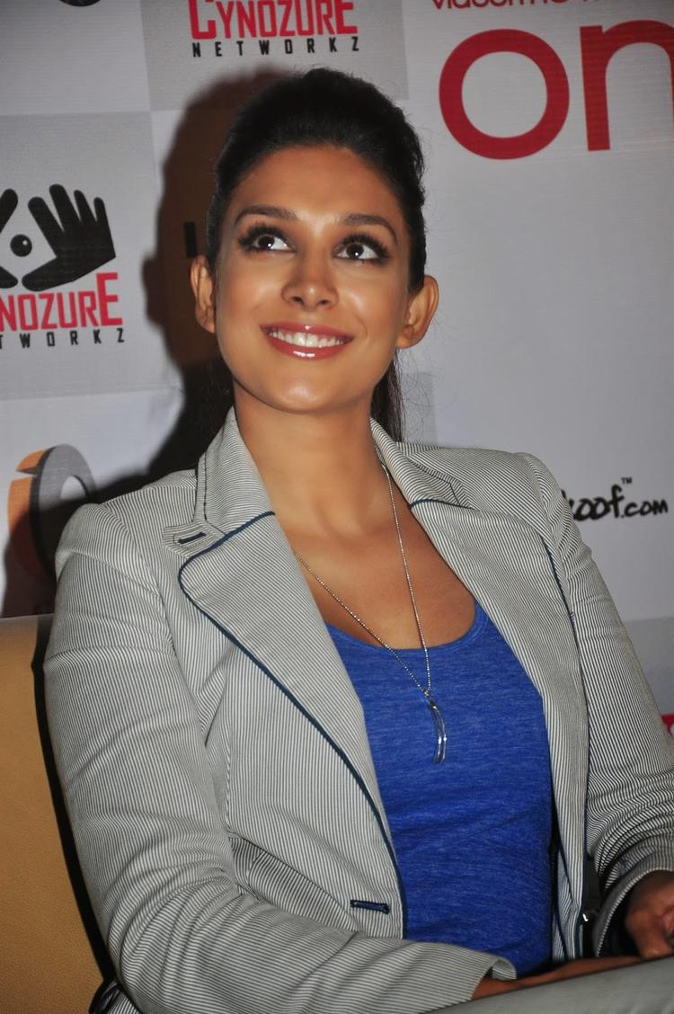 Preeti Desai Smiling Pose Still During The Launch Of One By Two Film Merchandise
