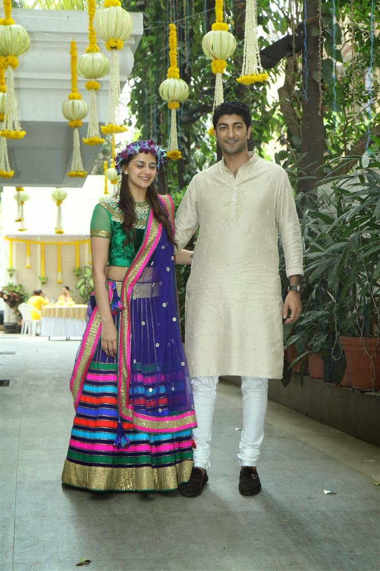 Couple Ahana And Vaibhav Posing For The Cameras At Their Mehendi Ceremony