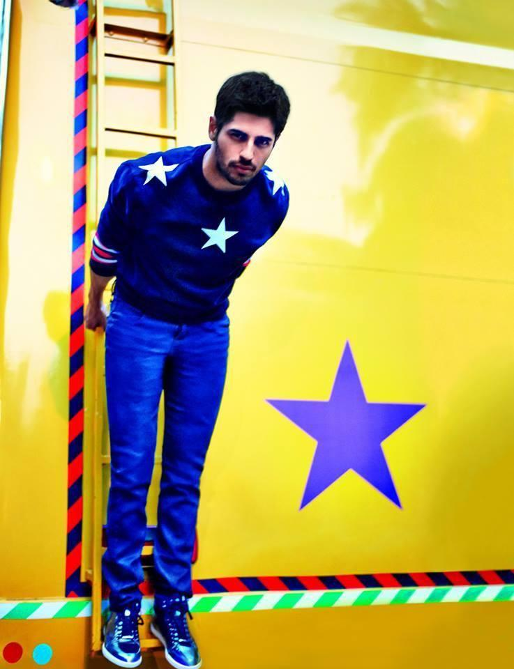 Charming Sidharth Malhotra Pose On A Ladder For GQ India 2014 Feb Issue