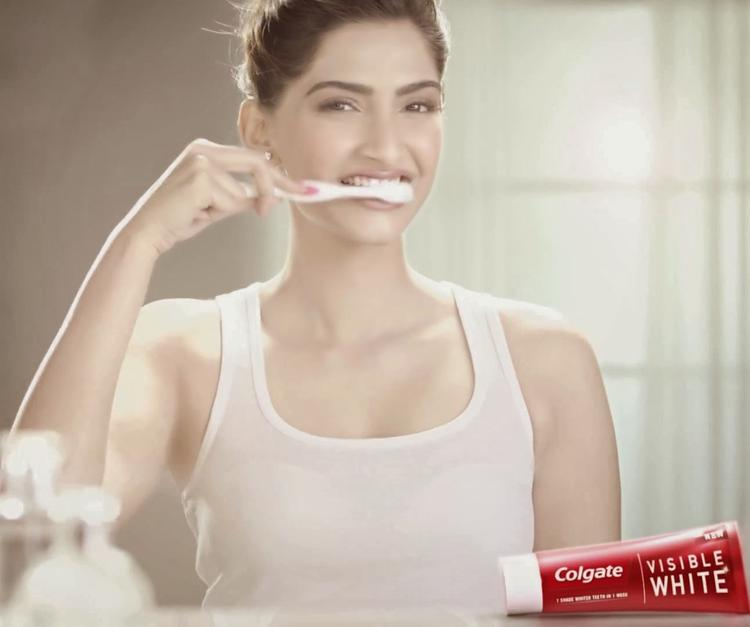 Fashionista Sonam Brush Her Teeth With Colgate Visible White Tothpaste