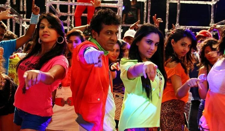 Shivaraj Kumar And Ramya Dancing Pose From Shivaraj Kumar's Aryan Kannada Movie
