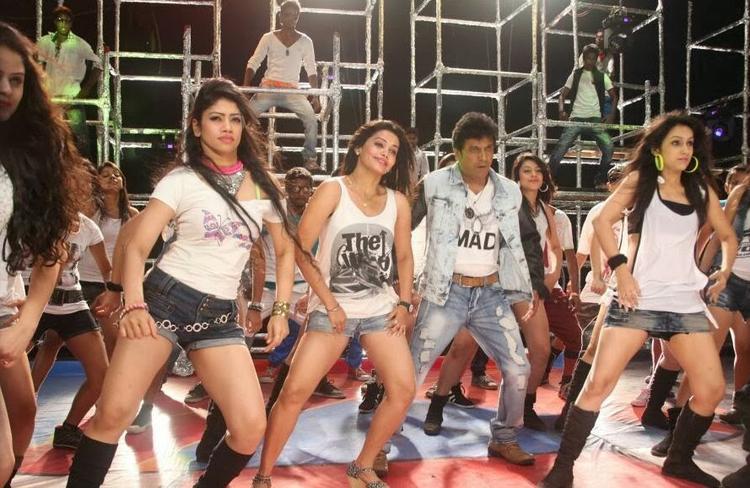 Shivaraj Kumar Dancing Pose Still From Shivaraj Kumar's Aryan Kannada Movie