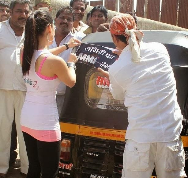 Sunny Leone Paste The Poster On The Backside Of  An Auto Rickshaw During The Promotion Of Ragini MMS 2 At Mumbai