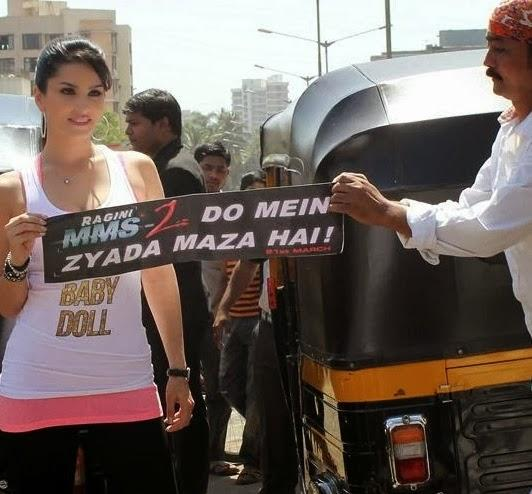 Sunny Leone Shows The Poster During The Promotion Of Ragini MMS 2 With Auto Rickshaw Ride