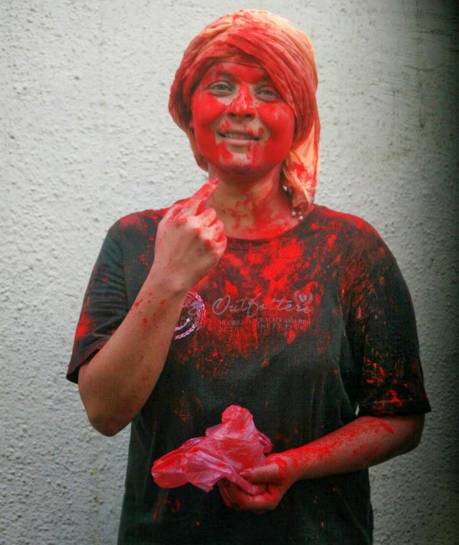 A Guest Pose With Colour At Bappi Lahiri Holi Celebration Party