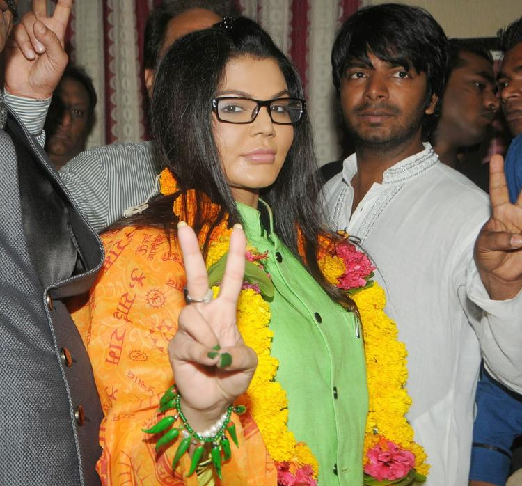 Rakhi Sawant Shows Victory Sign During The Launch Of Her New Party RAAP