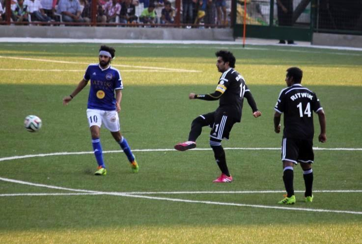Abhishek Bachchan Takes His Chance With The Football From Ranbir Kapoor At The Celebrity Football Match