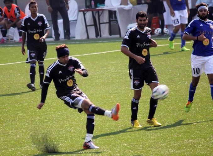 Ranbir Kapoor Aims A Kick And Aditya Roy Kapur Looks On At The Celebrity Football Match