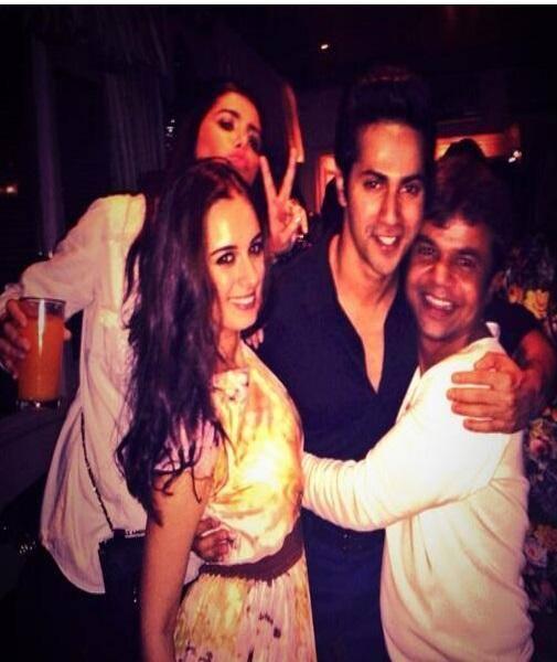 Varun Hugs Rajpal And Evelyn Smiling Pose At The Success Party Of Main Tera Hero