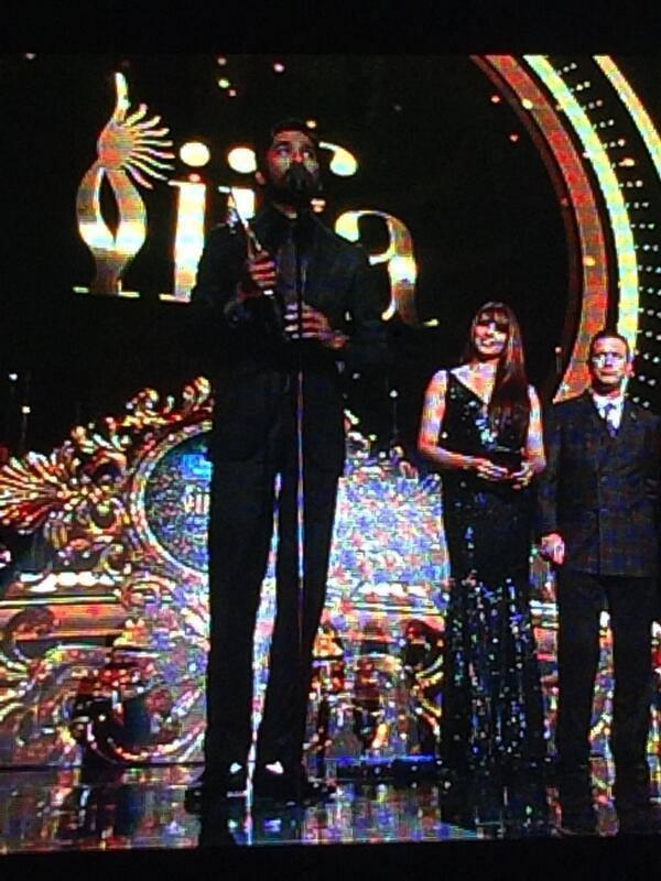 Dhanush With His Award On The Stage Of The IIFA Awards 2014 Event