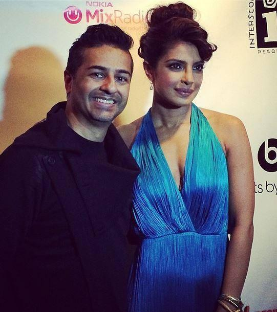 Priyanka Poses With A Fan At A Screening Of Her New Album 'I Can't Make You Love Me'.