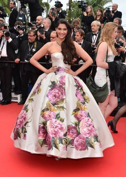 Sonam Kapoor Opted A Foral Print Dress Posed In Red Carpet At Cannes 2013 Film Festival