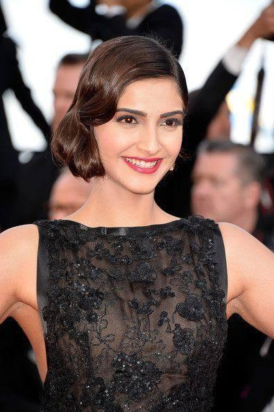 Sonam Poses For Photographers At The Homesman' Premiere During The 67th Cannes Film Festival